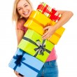 Young attractive laughing woman with gifts — Stock Photo