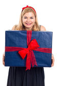 Smiling woman with big gift — Stock Photo