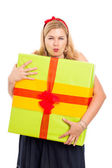 Greedy woman with gift — Stock Photo