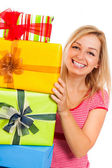 Young attractive happy woman with gifts — Stock Photo