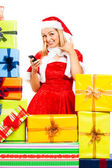 Happy female Christmas Santa on the phone — Stock Photo