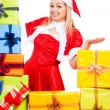 Royalty-Free Stock Photo: Happy female Christmas Santa with gifts