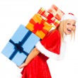 Laughing female Santa with Christmas gifts — Stock Photo
