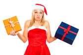 Funny indecisive Santa female with Christmas gifts — Stock Photo