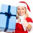 Happy Santa woman with Christmas gift — Stockfoto