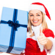 Foto Stock: Happy Santa woman with Christmas gift