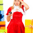 Stock Photo: Unhappy female Christmas Santa with mobile phone