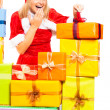 Funny female Santa opening Christmas gift — Stock Photo