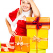 Smiling Santa woman and Christmas gifts — Stock Photo