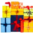 Many colorful Christmas gift boxes — Stock Photo #14339599