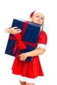 Greedy Santa woman with big Christmas gift box — Stock Photo