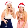 图库照片: Laughing women celebrating Christmas