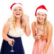Foto Stock: Laughing women celebrating Christmas