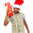 Curious boy with Christmas gift — Stock Photo