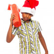 Curious boy with Christmas gift - Stock Photo