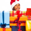 Happy boy and many Christmas gifts - Stock Photo