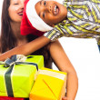 Ecstatic boy and woman celebrating Christmas - Stockfoto