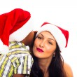 Stock Photo: Beautiful Christmas woman and boy whispering