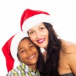 Happy woman and boy in Christmas hat — Stock Photo #14725755