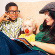 Woman and children reading book — Stock Photo