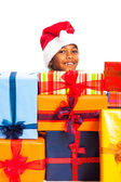 Happy boy and many Christmas gifts — Stock Photo