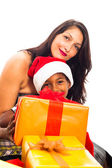 Beautiful woman with boy and Christmas gifts — Stock Photo