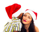 Beautiful Christmas woman and boy whispering — Stock Photo