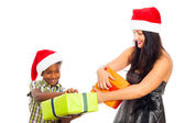 Happy woman and boy opening Christmas gifts — Stock Photo