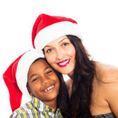Happy woman and boy in Christmas hat — Stock Photo