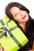 Attractive happy woman holding gift — Stock Photo