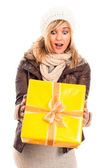 Surprised woman with gift box — Stock Photo