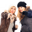 Women in winter clothes pointing at you — Stock Photo #15394837