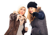 Women in winter clothes pointing at you — Stock Photo