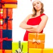 Satisfied Christmas woman and gifts — Stock Photo