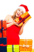 Surprised Christmas woman exploring gift — Stock Photo