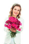 Happy woman giving pink flower — Stock Photo