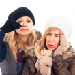 Unhappy women in winter clothes - Stock Photo