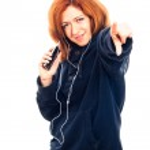 Happy woman with smartphone and headphones — Stock Photo