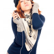 Young woman in winter clothes listening music — Stock Photo