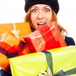 Ecstatic woman in winter hat with many gifts — Stock Photo #16858269