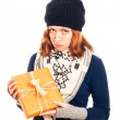 Unhappy woman with gift box — Stock Photo #16858299