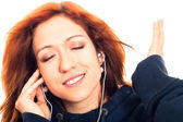 Young woman listening music — Stok fotoğraf