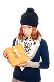 Unhappy woman with gift box — Stock Photo