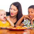 Royalty-Free Stock Photo: Family eating pizza