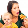 Royalty-Free Stock Photo: Woman eating pizza and child drinking