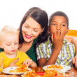 Happy family eating pizza — Stock Photo