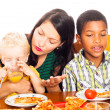 Woman with children having pizza lunch — Stock Photo