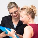 Happy businesswomen looking at document — Stock Photo