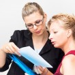 Serious businesswomen looking at document — Stock Photo