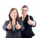 Happy businesswomen thumbs up — Stock Photo